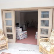 Glass shaker doors with purpose made oak frame room divider